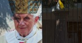 An image of Pope Benedict XVI is seen by