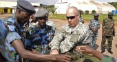 US soldiers assist Ugandan Airforce pers