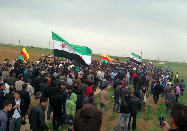 Syrians hold pre-Baath flags, which has