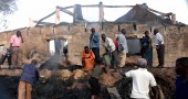 Ugandans sift through the burned out rem