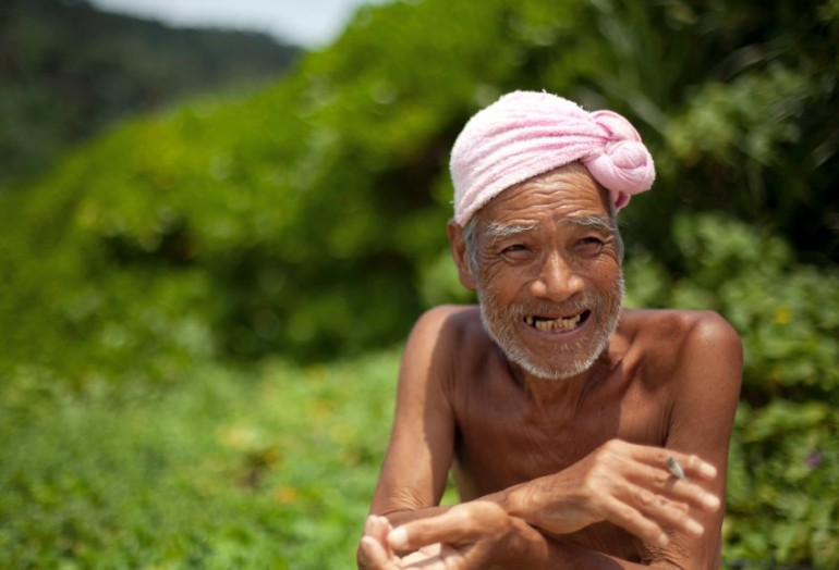 Seventy-six-year-old naked hermit Nagasaki speaks on Sotobanari island, Okinawa prefecture, Japan