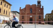 A man rides past Mirandola&##039;s cathedral,