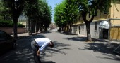 A man reacts in a street of Mirandola, d