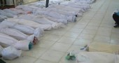 The bodies of  whom anti-government protesters say were killed by government security forces lie on the ground at Ali Bin Al Hussein mosque in Huola