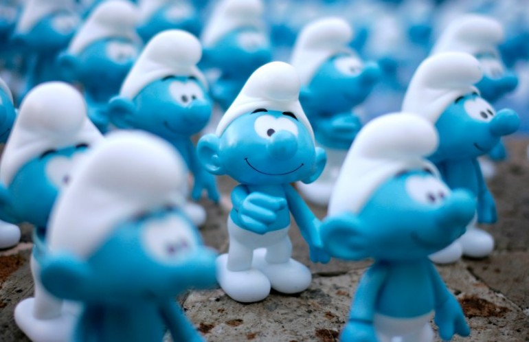 "Smurfs figurines are displayed on a fountain during a photocall for the film ""The Smurfs"" in Cancun"