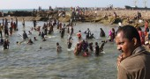 Image: Somalis swim at the Lido beach in Mogadishu, Somalia. The seaside capital of Mogadishu is full of life for the first time in 20 years.