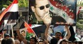 A supporter of Syrian President Bashar a