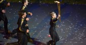 Young athletes carry the Olympic torch d