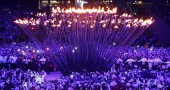 The Olympic Flame is lit during the open