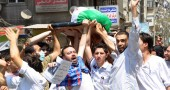 Syrians carry the body of a man allegedl