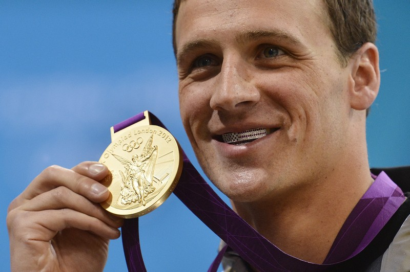 US swimmer Ryan Lochte poses on the podi