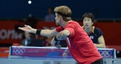 Michael Maze of Denmark serves to Jun Mi