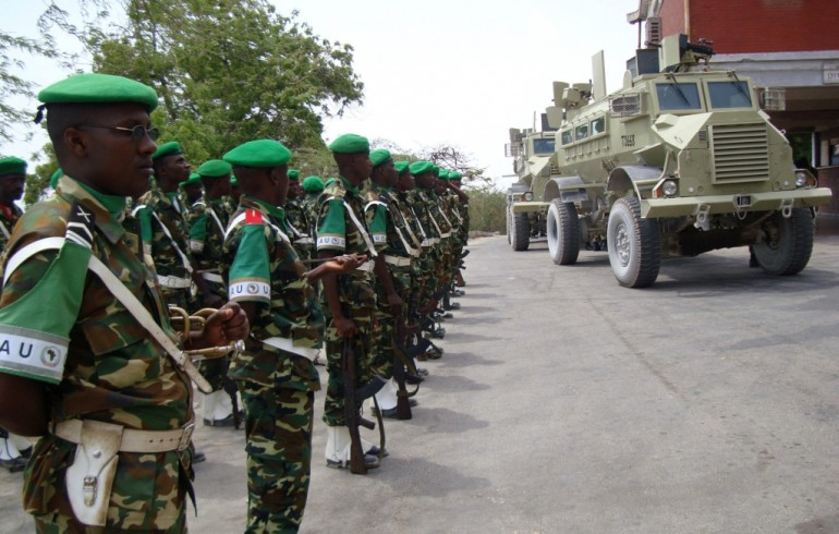 AMISOM peacekeepers parade before a convoy of APC ferrying Somalia's President Sheikh Sharif Ahmed during his visit to their operations around Hodon district of the capital Mogadishu