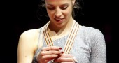 Italia Carolina Kostner poses with the m