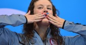 US swimmer Allison Schmitt blows a kiss