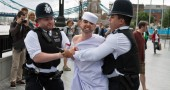British policemen take away an activist