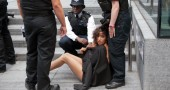 British policemen surround a topless act