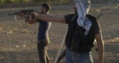 Syrian rebel fighters shoot during targe