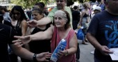 Greek citizens receive free milk at Synt