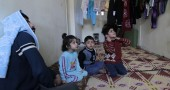 members of a Syrian refugee family fleei