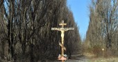 A cross is pictured in the ghost city of