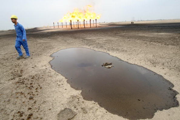 An engineer walks across the Zubair oil