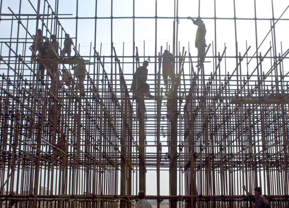 Pakistani laborers work on a constructio