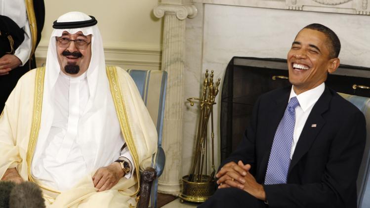 u-s-president-barack-obama-r-laughs-he-meets-king-abdullah-saudi-arabia-20140328