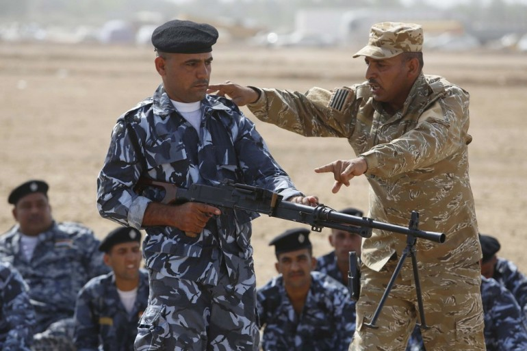 IRAQ-UNREST-SHIITES-VOLUNTEERS