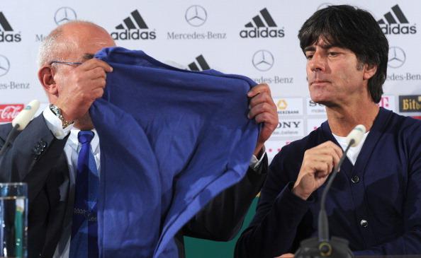 Germany's head coach Joachim Loew (R) lo