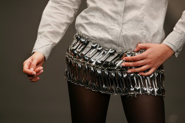 A model shows a mini skirt made out of s