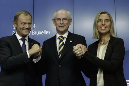 Donald Tusk, Herman Van Rompuy e Federica Mogherini, AP Photo/Yves Logghe