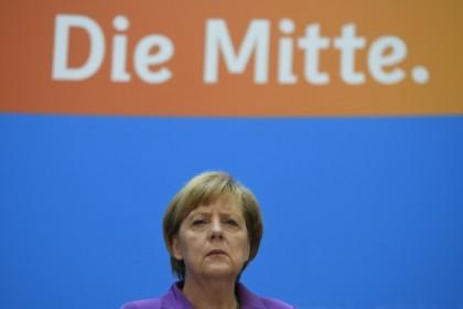 Angela Merkel. Photocredit: TOBIAS SCHWARZ/AFP/Getty Images)