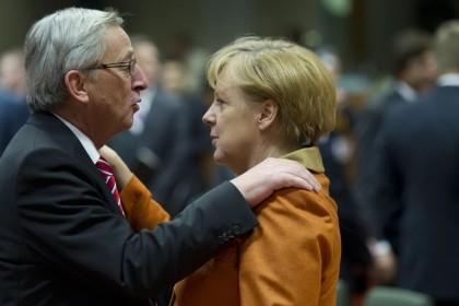 Jean-Claude Juncker e Angela Merkel. AP Photo/Geert Vanden Wijngaert, file