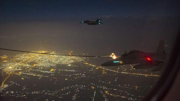 aw-Two-Australian-FA-18F-Super-Hornet--20141007022327893418-620x349
