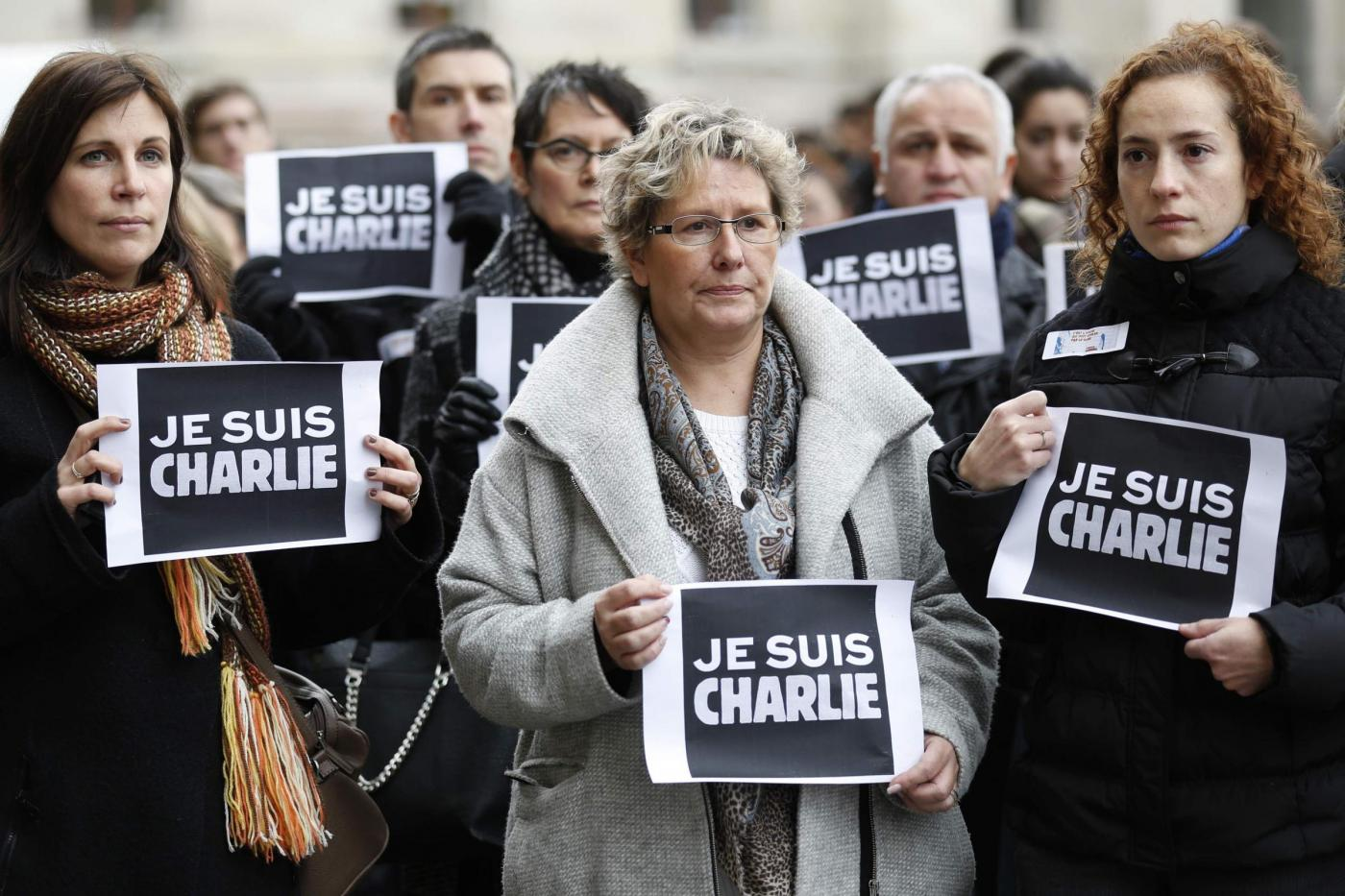 "People holds placards which read ""I am Charlie"" during a minute of silence in Strasbourg for victims of the shooting at the Paris offices of weekly satirical newspaper Charlie Hebdo on Wednesday"