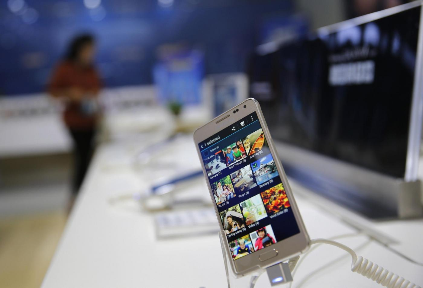 A Samsung Galaxy Alpha smartphone is displayed at a Samsung showroom in Jakarta