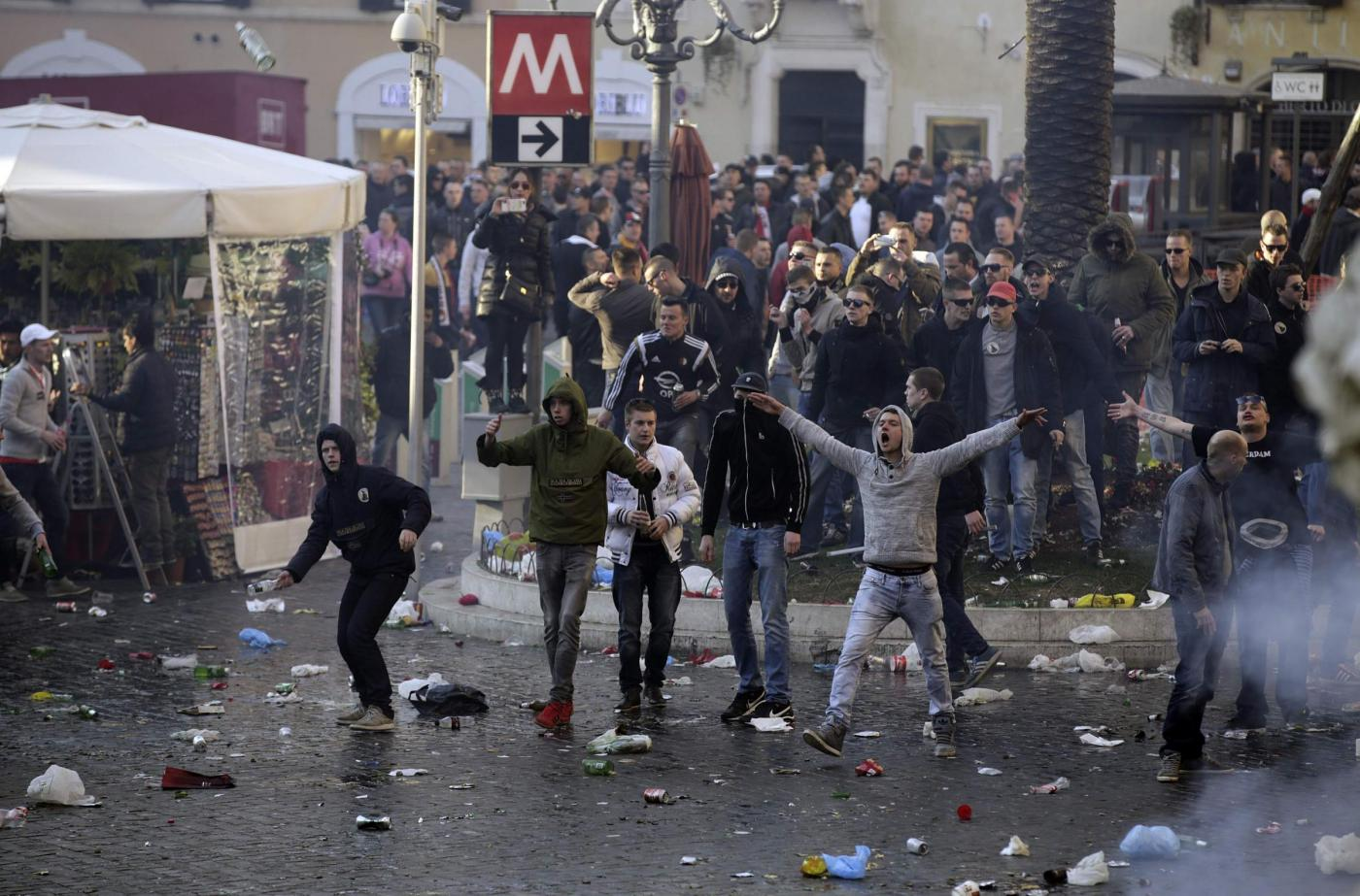 Feyenoord fans gesture and shout during clashes at the Spanish Steps prior to the start of the Europa League soccer match between Roma and Feyenoord in Rome