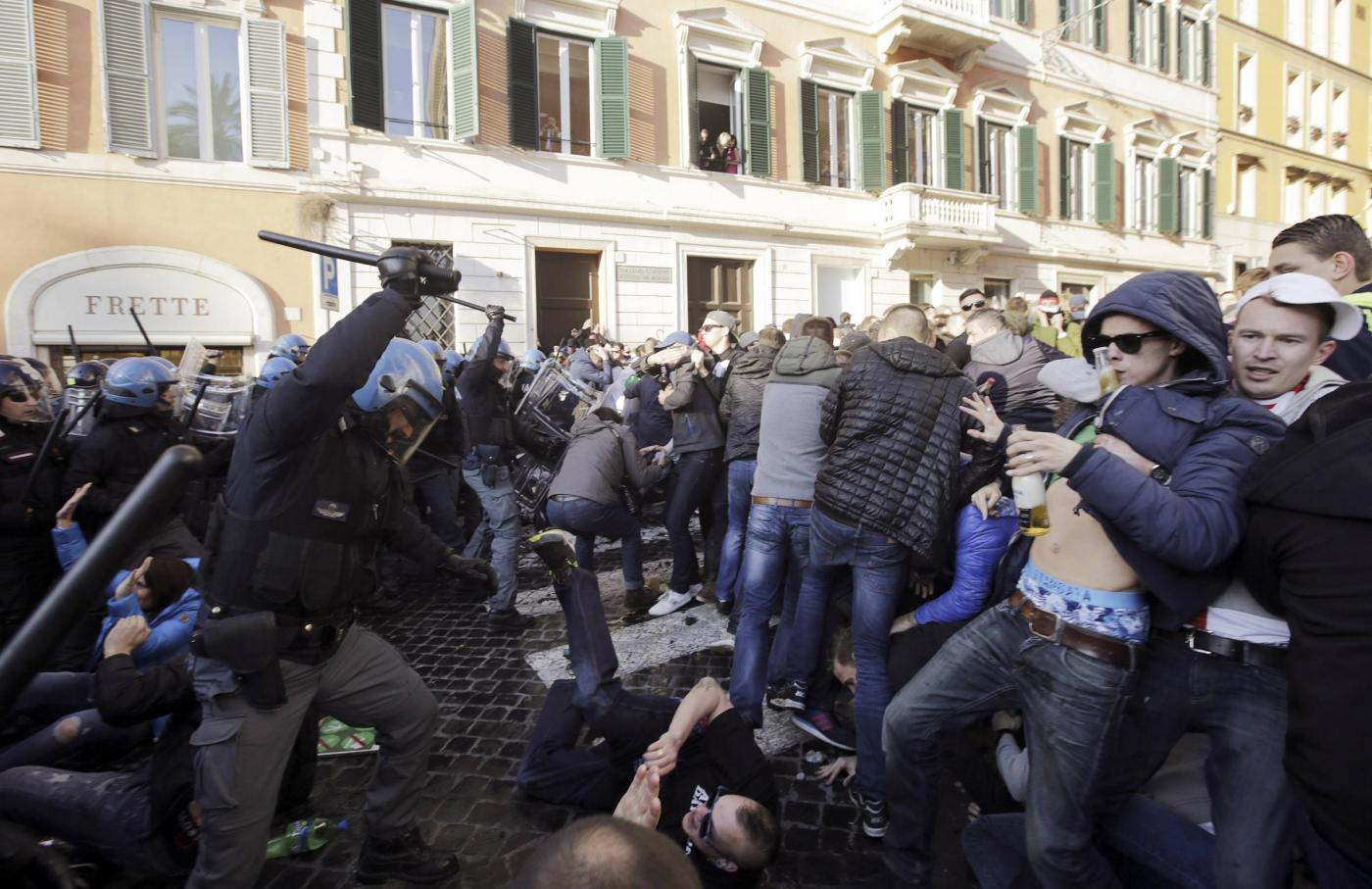 Feyenoord fans clash with police at the Spanish Steps prior to the start of the Europa League soccer match between Roma and Feyenoord in Rome