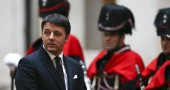 Italian Prime Minister Renzi looks on as he waits for the arrival of his Greek counterpart Alexis Tsipras at Chigi palace in Rome