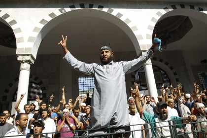 Protesters shout slogans during a demonstration at the al-Fatah mosque in Tunis