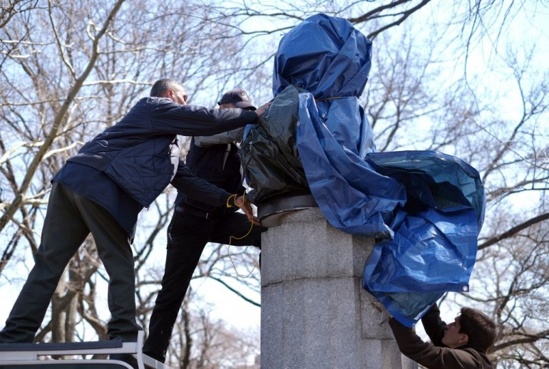New York City Department of Parks and Recreation employees take down a statue of former National Security Agency (NSA) contractor Edward Snowden at the Fort Greene Park in Brooklyn, New York, on April 6, 2015. A group of artists on Monday installed a bust of fugitive US intelligence analyst Edward Snowden on a war memorial in a New York park, though authorities quickly removed the illicit statue. Snowden, 31, a former contractor at the US National Security Agency, has lived in exile in Russia since 2013 after revealing mass spying programs by the United States and its allies. AFP PHOTO/ JEWEL SAMAD (Photo credit should read JEWEL SAMAD/AFP/Getty Images)