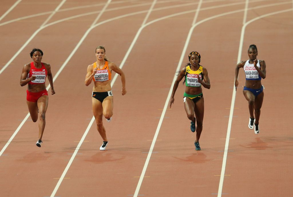 Candyce McGrone of the United States, Dafne Schippers of the Netherlands, Elaine Thompson of Jamaica and Dina Asher-Smith of Great Britain compete in the Women's 200 metres final during day seven of the 15th IAAF World Athletics Championships Beijing 2015 at Beijing National Stadium on August 28, 2015 in Beijing, China. (Photo by Lintao Zhang/Getty Images for IAAF)