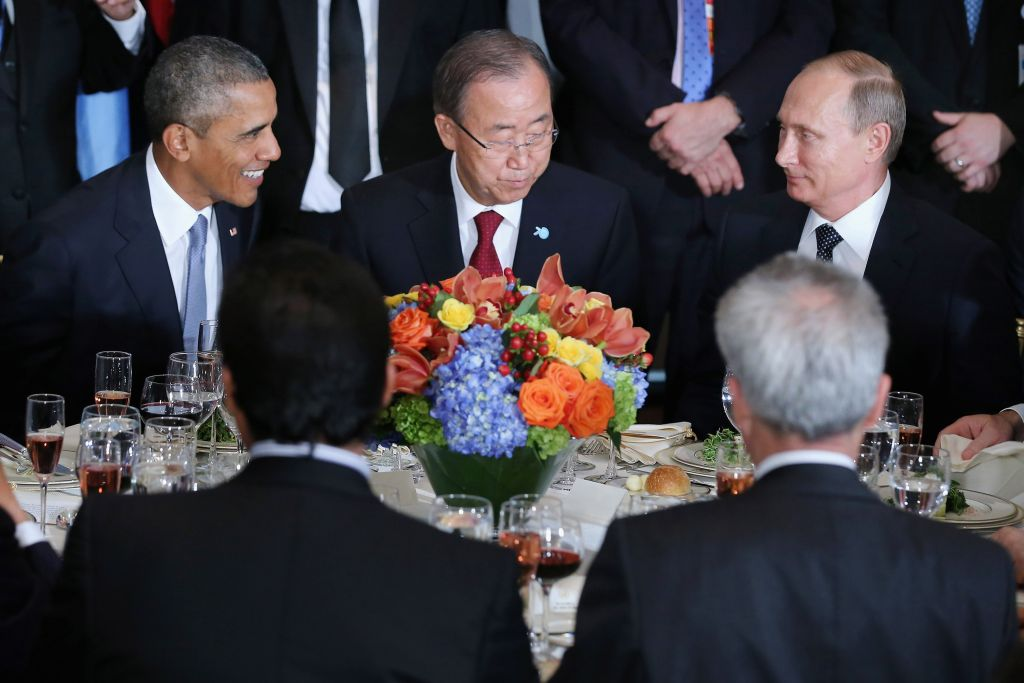 Barack Obama, United Nations Secretary-General Ban Ki-moon and Russian President Vladimir Putin sit together during a luncheon hosted by Ki-moon during the 70th annual UN General Assembly at the UN headquarters September 28, 2015 in New York City. Obama held a bilateral meeting with Indian Prime Minister Narendra Modi and with have a face-to-face meeting with Russian President Vladimir Putin later in the day.  (Photo by Chip Somodevilla/Getty Images)
