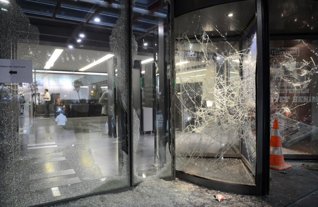 This photo taken on September 8, 2015 shows broken windows of the headquarters of the Hurriyet newspaper on September 8, 2015, in Istanbul's Bagcilar district, after an attack. Supporters of Turkey's ruling Justice and Development Party (AKP) stormed the headquarters of the Hurriyet newspaper today in Istanbul after accusing the daily of misquoting President Recep Tayyip Erdogan. The attack on the newspaper comes amid growing concern over press freedoms in Turkey and the use of the courts by the president to pursue journalists who criticise him. AFP PHOTO / HURRIYET DAILY (Photo credit should read -/AFP/Getty Images)
