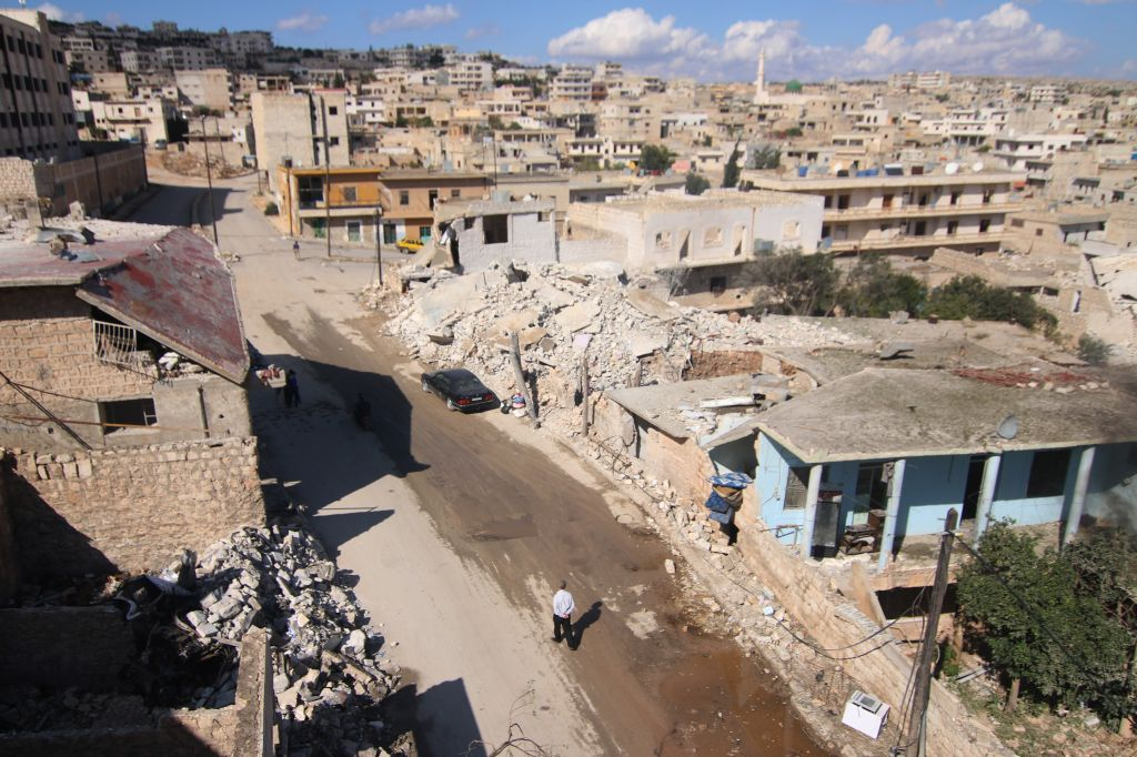 A general view shows damaged buildings in the town of Darat Azzah, west of the northern Syrian city of Aleppo, following reported bombings by government forces on October 7, 2015. Earlier in the day Syrian regime forces, supported by heavy Russian aerial bombing and cruise missile strikes from warships, launched a major ground offensive against rebels in a coordinated attack in Hama province. AFP PHOTO / AMC  / FADI AL-HALABI        (Photo credit should read Fadi al-Halabi/AFP/Getty Images)