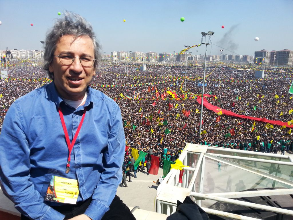 journalist Can Dundar during a Newroz celebration in Diyarbakir. Prominent Turkish journalist Dundar says he misses the media censorship that followed a bloody 1980 military coup -- at least then, journalists knew where they stood. The 52-year-old, who was ousted this summer from the liberal paper where he had worked since 2001, believes that a new, more insidious form of censorship is silencing dissent at a crucial time for Turkey. 'As a journalist who witnessed the September 12 period, I can say I miss the censorship of that era. When a story was banned, a military official would tell you in the morning and the story would not be published,' said Dundar, referring to the aftermath of the 1980 coup. Now, he told AFP, media organisations including his former paper, Milliyet, are so fearful of repercussions that they self-censor. 'I know that even pictures of the prime minister where he does not look good caused discomfort within the newspaper.' AFP PHOTO/STR (Photo credit should read STR/AFP/Getty Images)