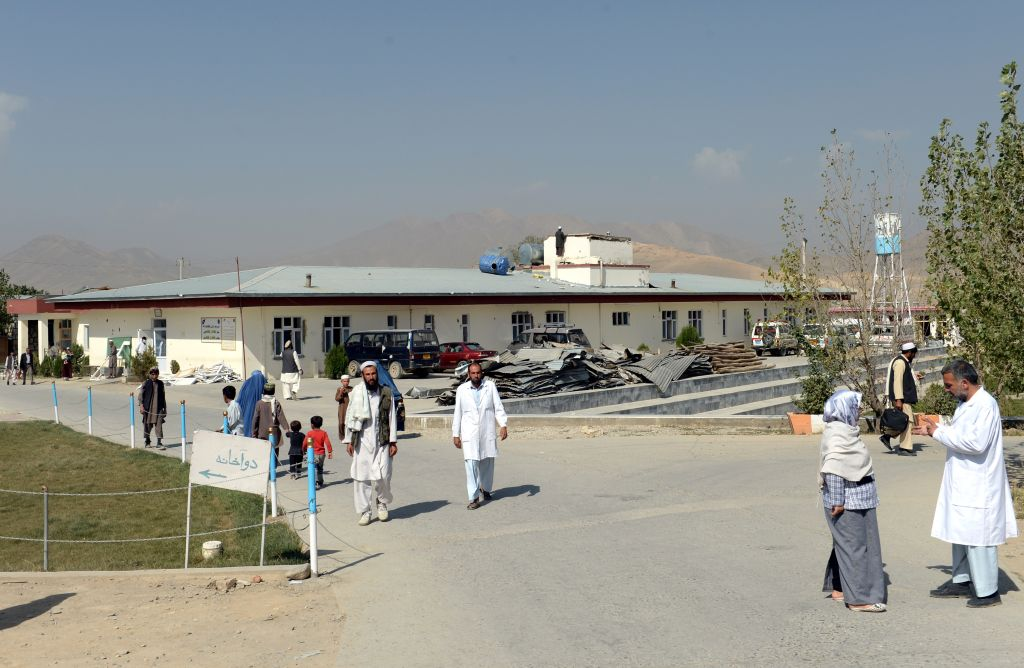 Edouard GUIHAIRE In this picture taken on September 23, 2013, Afghan men and women walk in Maidan Shar hospital in Maidan Shar city, capital of Wardak province. A Taliban attack wrecked the operating theatre and left 160 staff and patients wounded, but the Maidan Shar hospital has never stopped serving the people of one of the most dangerous parts of Afghanistan. AFP PHOTO/Shah MARAI (Photo credit should read SHAH MARAI/AFP/Getty Images