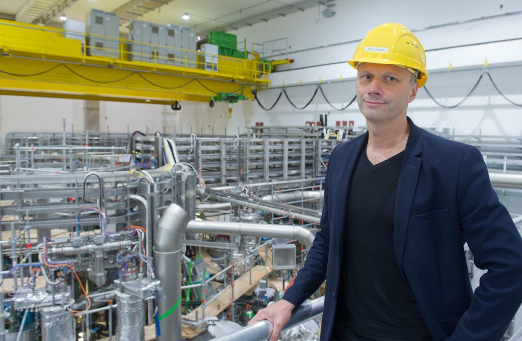 Thomas Klinger, director of the Max Planck Institute for Plasma Physics in Greifswald, northeastern Germany, poses in front of the Wendelstein 7-X fusion device on September 18, 2015. According to the institute, the Wendelstein 7-X fusion device is the worlds largest and most advanced device of the stellarator type. The objective of fusion research is to develop a power plant favourable to the climate and environment that derives energy from the fusion of atomic nuclei just as the sun and the stars do. AFP PHOTO / DPA / STEFAN SAUER +++ GERMANY OUT +++ / AFP / DPA / STEFAN SAUER (Photo credit should read STEFAN SAUER/AFP/Getty Images)