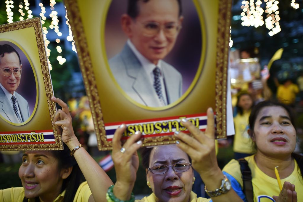 Bhumibol Adulyadej as they sing songs to celebrate his 88th birthday at the Siriraj hospital where the King has been staying for months in Bangkok on December 5, 2015. Thai King Bhumibol, the world's longest reigning monarch who is regarded as a demi-god by many Thais and considered a unifying force in a politically turbulent nation, turned 88 on December 5, 2015. AFP PHOTO / Christophe ARCHAMBAULT / AFP / CHRISTOPHE ARCHAMBAULT        (Photo credit should read CHRISTOPHE ARCHAMBAULT/AFP/Getty Images)